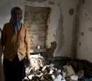 Мария Ивановна в развалинах своего дома
